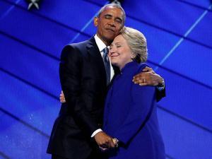 President Barack Obama hugs Democratic Presidential candidate Hillary Clinton