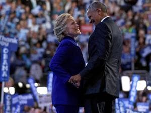 President Barack Obama talks with Democratic presidential candidate Hillary Clinton