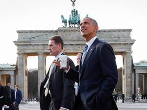 President Barack Obama walks past the Brandenburg Gate in Berlin