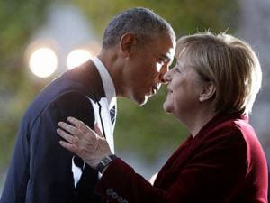 U.S. President Barack Obama is welcomed by German Chancellor Angela Merkel prior to a meeting in the chancellery in Berlin