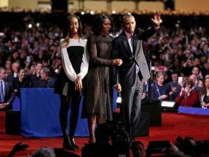 President Barack Obama waves as he is joined by First Lady Michelle Obama and daughter Malia Obama