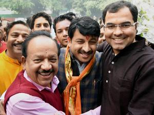New BJP Delhi President Manoj Tiwari  is greeted by Union minister Harsh Vardhan