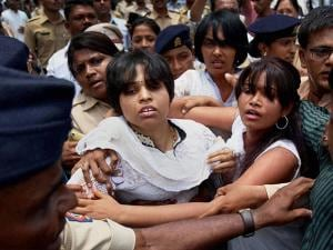 Police stop Rangaragini Bhumata Brigade (RBB) leader Trupti Desai and her supporters from entering the Kapaleshwar Temple in Nasik district of Maharashtra