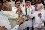 Congress leader celebrating the party's victory in two of three assembly seats which wen to polls