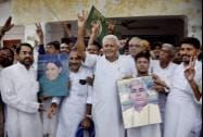 Rashtriya Janata Dal supporters celebrate after declaration of Bihar bypoll results