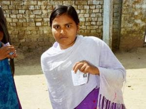 A disabled girl arrives at polling booth to cast her vote