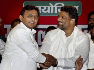 Uttar Pradesh Chief Minister Akhilesh Yadav greets Jan Adhikar party Chief Pappu Yadav