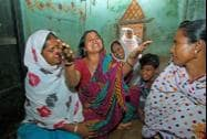 Family members mourn the death of Tausif Sheikh who was allegedly murdered by the TMC goons at Makra village
