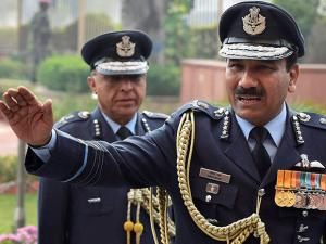 Outgoing Chief of Air Staff Air Chief Marshal Arup Raha waves during his send off