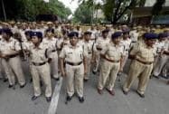 Police women stand guard outside the residence of Delhi CM