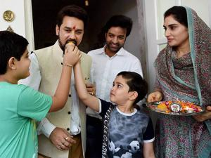 BCCI president Anurag Thakur being greeted by his children at his residence in New Delhi