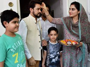 BCCI president Anurag Thakur being greeted by his wife and children at his residence in New Delhi