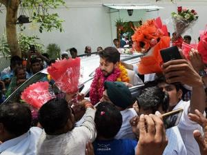 BCCI president Anurag Thakur being greeted by supporters at his residence in New Delhi