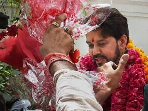 BCCI president Anurag Thakur being greeted by supporters at his residence in New Delhi (2)