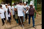 """Visually Impaired kids with volunteers take part in a """"Blind Walk"""" to spread the awareness on blindness"""