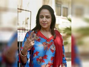 Hema Malini displays the indelible ink mark on their fingers