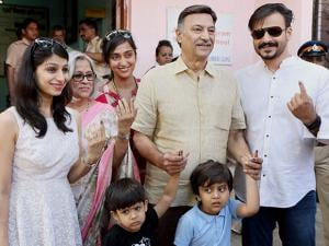 Vivek Oberoi, along with his father Suresh Oberoi, mother, sister, wife and sons after casting their votes at Juhu