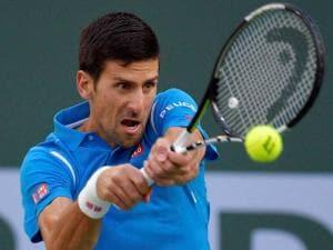 Novak Djokovic, of Serbia, returns a shot to Bjorn Fratangelo at the BNP Paribas Open tennis tournament