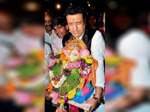 Govinda carries an idol of Lord Ganesh for immersion