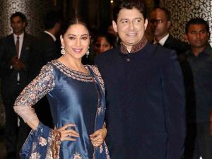 Actor Madhuri Dixit Nene with husband Sriram Nene at the wedding reception of Preity Zinta and Gene Goodenough, in Mumbai