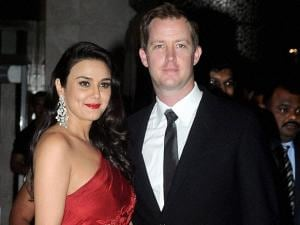 Actress Preity Zinta and her husband Gene Goodenough pose for media during their Wedding Reception in Mumbai