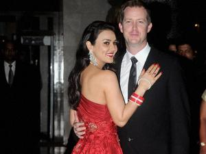 Actress Preity Zinta and her husband Gene Goodenough pose for media during their Wedding Reception in Mumbai (2)