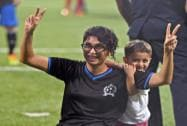 Bollywood actor Aamir Khan's wife Kiran Rao with son Azad during a charity football match in Mumbai