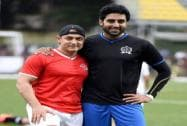 Bollywood actors Amir Khan and Abhishiek Bachchan during a charity football match in Mumbai