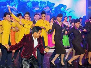 Etihad Airways and Jet Airways cabin crew take part in a spontaneous Bollywood-style flash mob dance at Etihad Airways' official Airbus A380 India launch event in Mumbai