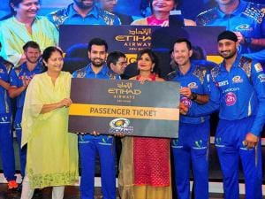 Mumbai Indians stars Harbhajan Singh, Ricky Ponting and Rohit Sharma hands over a pair of business class ticket to Pallavi Kapadia, President of Incredible Vacations, at Etihad Airways' official Airbus