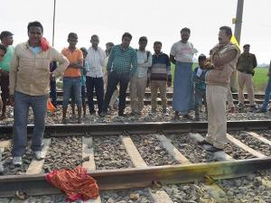 Police and locals at the railway tracks after a blast near Buxar station