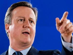 British Prime Minister David Cameron addresses the media during an EU summit in Brussels