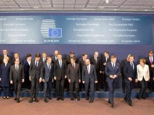EU Heads of State and Government leave the stage after a group photo at an EU summit in Brussels