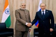 Prime Minister Narendra Modi shakes hands with Russian President  Vladimir Putin during a meeting at Fortaleza in Brazil on Tuesday