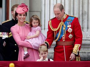 Kate holds Princess Charlotte with Prince William with Prince George