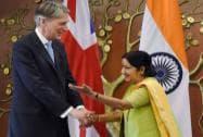 External Affairs Minister Sushma Swaraj shakes hands with British Foreign Secretary Philip Hammond