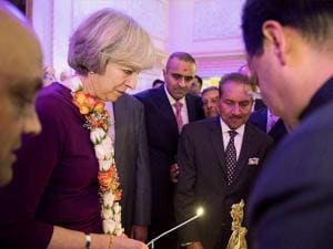 Theresa May with the Indian entrepreneurs lighting lamps