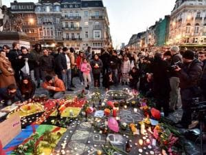 Brussels People bring flowers and candles to mourn at Place de la Bourse in the center of Brussels