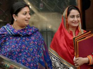 Minister Smriti Irani and Harsimrat Kaur Badal after a Cabinet meeting at South Block