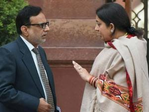 HRD Minister Smriti Irani talks to Revenue Secretary Hasmukh Adhia after a Cabinet meeting