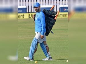 Indian captain M.S.Dhoni walks out from the field at the end of their training session