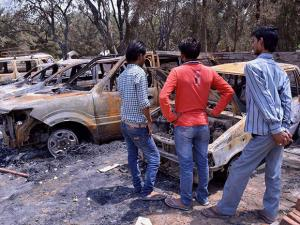 Charred vehicles inside the Jawahar Bagh that was opened for the public
