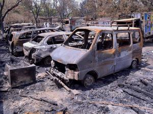 Charred vehicles inside the Jawahar Bagh that was opened for the public in Mathura