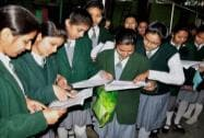Students in Moradabad give a last look to their notes