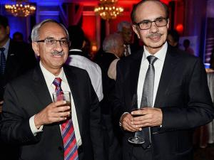 Managing Director of Godrej industries, Nadir Godrej (L) and Chairman of Godrej group, Adi Godrej (R) pose together during a party to celebrate the 90th birthday of the Queen Elizabeth II in Mumbai