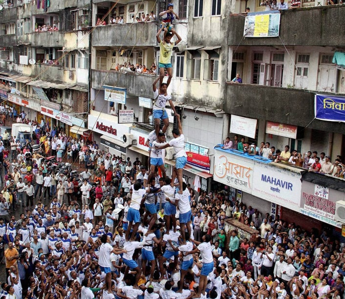 Govinda, mandal, breaking, Dahi handi, earthen pot, filled, curd, Janmashtami, celebrations, Mumbai