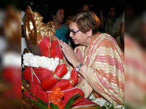 Helen offers prayers to Lord Ganesh during a Ganesh immersion procession