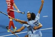 India's captain Sardar Singh, celebrate with teammate Chandanda Thimmaiah after scored India's  fourth goal