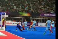 Indian players score a goal against Belgium in the quarterfinal at Champions Trophy
