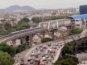 A Chennai Metro Rail train runs on the tracks between the Airport and Little Mount